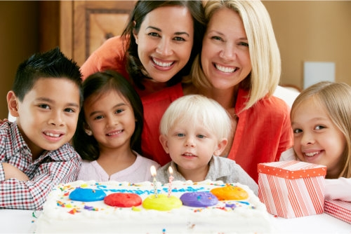two woman and children celebrating birthday
